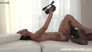 Masseuse slowly rubs oil to hot brunette